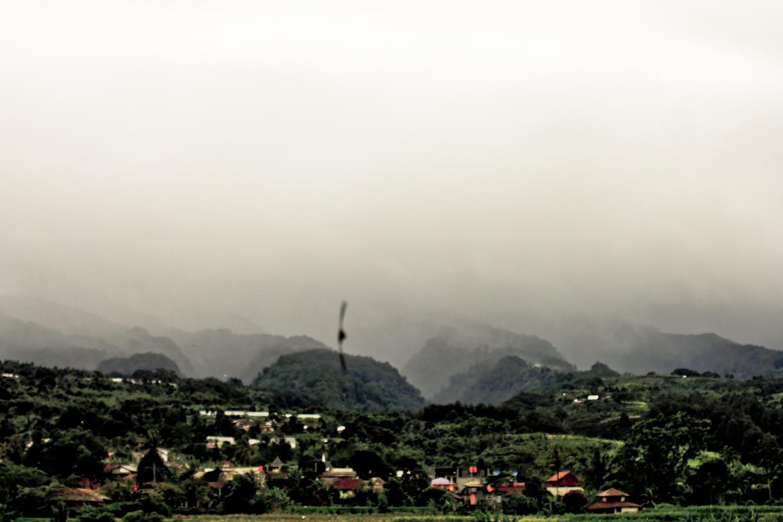 Desa-desa di Megamendung berselimut kabut dan berpayung mendung.